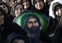 1613664_6_4536_des-femmes-turques-chiites-tiennent-un-portrait