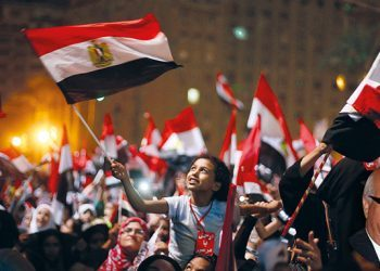 Protesters react after President Mohammed Morsi was ousted by the military on Wednesday in Tahrir Square in Cairo. The head of Egypt's armed forces General Abdel Fattah El Sissi issued a declaration suspending the constitution and appointing Egypt's chief justice as interim head of state.