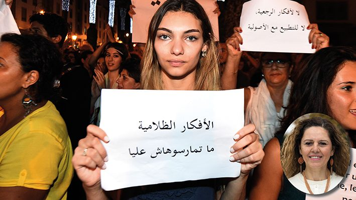 """Moroccans shout slogans and hold placards during a demonstration in Rabat on July 6, 2015. The protesters demonstrated for freedom and against the arrest of two Moroccan women after their outfits were deemed inappropriate as they strolled through an open-air market in the southern city of Agadir; and against the assault of a gay man in the city of Fez. The women were arrested on June 16 and charged with """"gross indecency.""""  AFP PHOTO/ FADEL SENNA / AFP PHOTO / FADEL SENNA"""